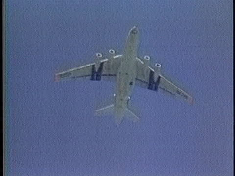 soviet gunship flies over kabul and a military plane drops flares as the soviet union begins withdrawal from its war with afghanistan. - helicopter stock videos & royalty-free footage