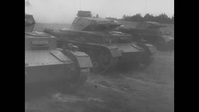 vidéos et rushes de soviet infantry moving through rural areas/ tank battle/ german soldiers moving on armored vehicles/ combat in city - battle
