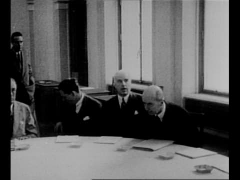 vídeos de stock e filmes b-roll de soviet leader joseph stalin sits at table for yalta conference proceeding pan to us president franklin roosevelt seated at table / ws the... - joseph stalin