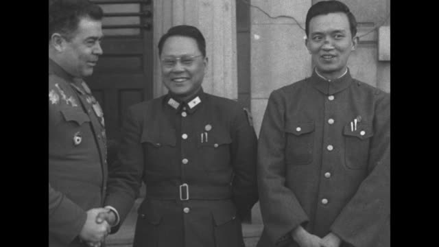 soviet major general andrei kovtun-stankevich, chinese maj. gen. peng pi-sheng, peng aide shih tze-tsan / note: exact day not known - manchuria stock videos & royalty-free footage
