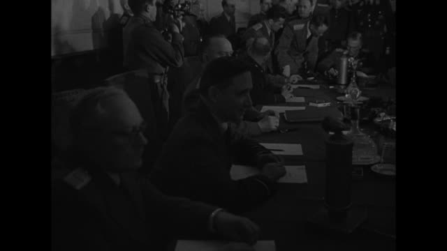 vídeos de stock, filmes e b-roll de soviet marshal georgy zhukov and other allied officers enter conference room where surrender will be signed / officers gathered around conference... - forças aliadas
