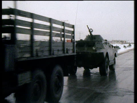 soviet military vehicles pass on road outside kabul soviet invasion of afghanistan 1982 - ehemalige sowjetunion stock-videos und b-roll-filmmaterial