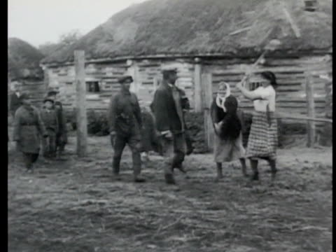 soviet partisans soldiers escorting prisoners in village women beating man w/ stick another w/ shovel walking toward barn woman hitting traitor w/... - firing squad stock videos & royalty-free footage