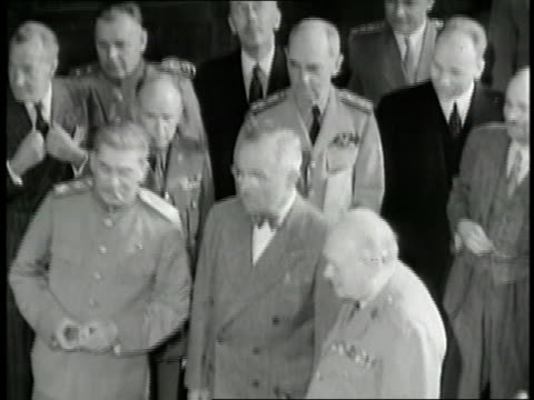 soviet premier joseph stalin united states president harry s truman british prime minister winston churchill and officials stand in a large room at... - potsdam conference stock videos and b-roll footage