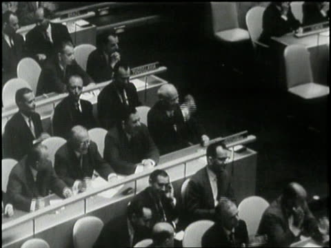 Soviet Premier Nikita Khrushchev and delegates pound their fists on a table at the United Nations General Assembly in New York City New York in 1960