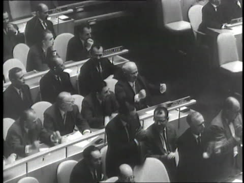 Soviet Premier Nikita Khrushchev and other Soviet delegates pound their fists during a United Nations meeting