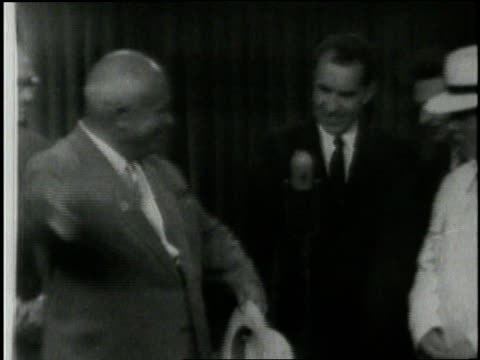 soviet premier nikita khrushchev and us vice president richard nixon walk through the american national exhibit giving an impromptu television debate - 1959 stock-videos und b-roll-filmmaterial