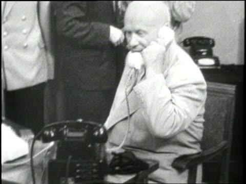 Soviet Premier Nikita Khrushchev speaks on the telephone with Soviet cosmonaut Andrian Nikolayev aboard the Vostok3