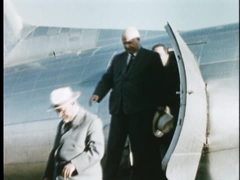 soviet premier nikolai bulganin and general secretary nikita khrushchev disembark from their plane as they arrive for a 1955 visit to india. - (war or terrorism or election or government or illness or news event or speech or politics or politician or conflict or military or extreme weather or business or economy) and not usa stock videos & royalty-free footage