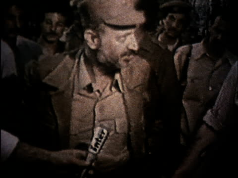 soviet propaganda dealing with israeli aggression in lebanon/ arafat talks to journalists and points to bombs/ injured people in bombed hospital - beirut stock videos & royalty-free footage