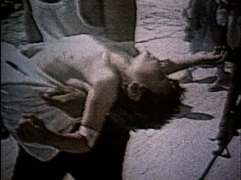 soviet propaganda dealing with israeli aggression in lebanon/ injured child/ soviet speech - プロパガンダ点の映像素材/bロール