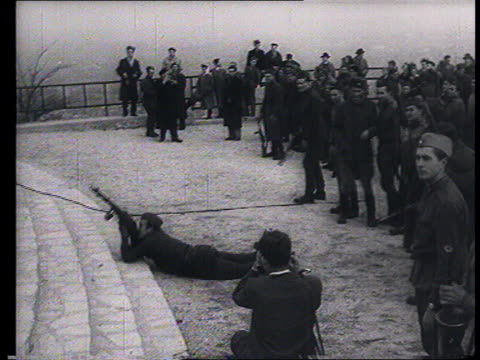 vídeos de stock e filmes b-roll de soviet propaganda documentary film. soviet intervention in budapest , guerrilla warfare : communist emblems removed from official buildings by... - 1956