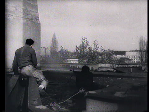 stockvideo's en b-roll-footage met soviet propaganda documentary film soviet intervention in budapest guerrilla warfare communist emblems removed from official buildings by population... - 1956