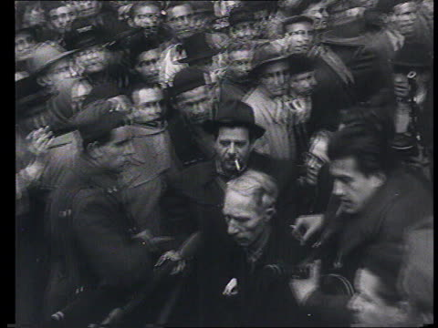 vídeos de stock e filmes b-roll de soviet propaganda documentary film. soviet intervention in budapest , guerrilla warfare : street scenes in damaged city, guerilla, fights, people... - 1956