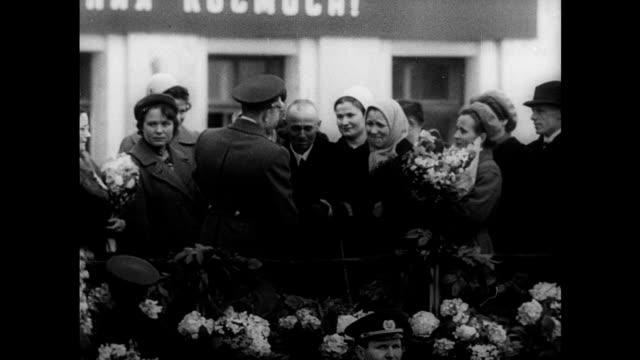 / Soviet propaganda film commemorating Yuri Gagarin's first manned space flight montage Nikita Khrushchev hugs and kisses Yuri Gagarin on viewing...