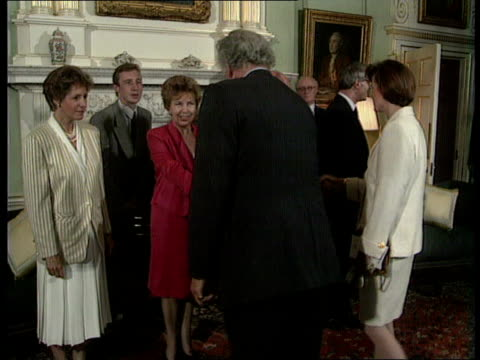 Soviet reforms/Western aid BV Guests shaking Raisa Gorbachev Norma Major as Major Gorbachev stand PAN LR Margaret Thatcher husband Denis arrive...