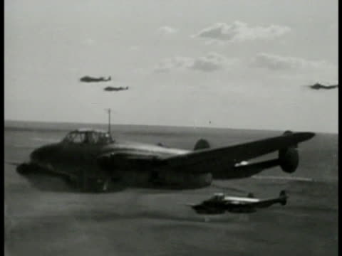 soviet russia petlyakov pe-2 light bomber in flight few others bg. explosion on ground. explosion incendiary bomb w/ long smoke flash. artillery fire... - 1944 stock-videos und b-roll-filmmaterial