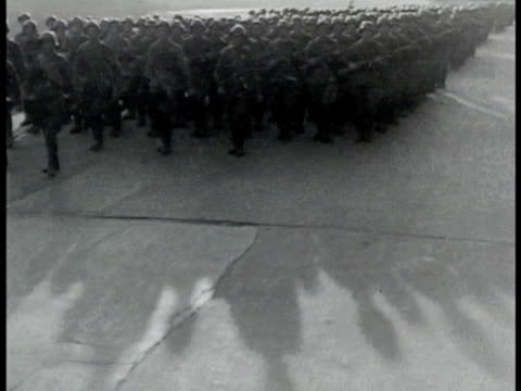 Soviet Russia Russian soldiers marching on street next to Moskva River in parade formation HA WS Same soldiers marching in formation Eastern Front...