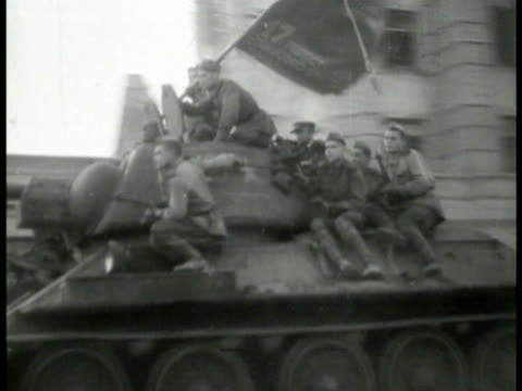 soviet russia tanks & soldiers on town street . soviet soldiers tearing down nazi sign ripping swastika banner. soviet generals. wwii - 1944 stock videos & royalty-free footage