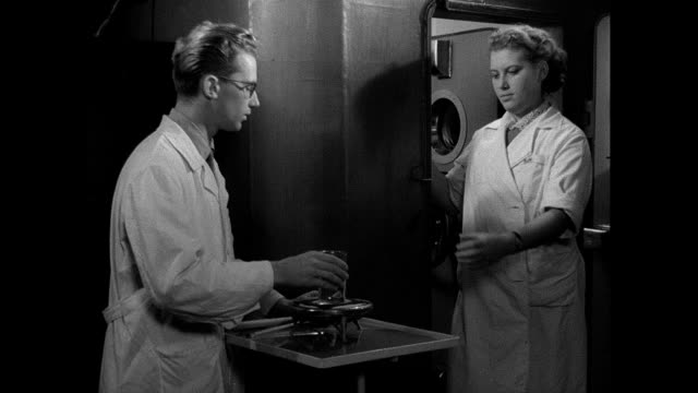 soviet scientist subjects rabbit to experiment in pressurized chamber - rabbit animal stock videos & royalty-free footage