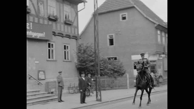 soviet soldier on horse rides past house with sign - postwar stock videos & royalty-free footage