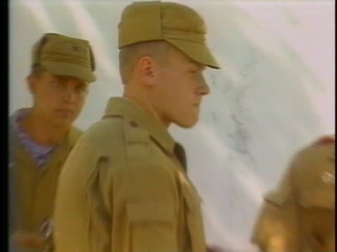vidéos et rushes de soviet soldiers and tanks prepare to pull out of kabul, afghanistan. - kaboul