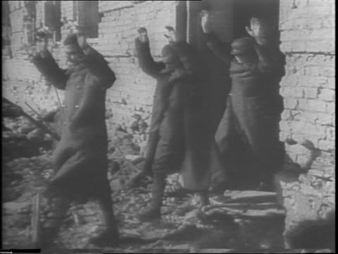 soviet soldiers running up stairs in dark interior / low angle shot of soviet soldier throwing grenade from bunker / explosion in middle of urban... - volgograd stock videos & royalty-free footage