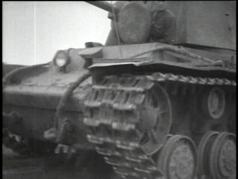 soviet tank moving across a bridge / red army soldiers unloading boxes and crates - ehemalige sowjetunion stock-videos und b-roll-filmmaterial