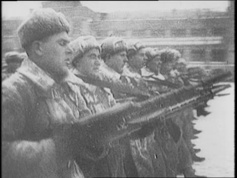 soviet tanks moving through snowy streets of moscow / camera shows soldiers in winter clothing lining streets / joseph stalin addressing his soldiers... - moscow russia stock videos & royalty-free footage