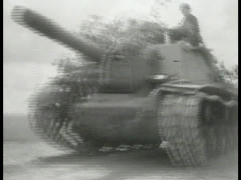 soviet tanks up road. soviet tank passing. soft focus russian soldiers smoking cigarette in trench soviet 'red' soldier using binoculars standing in... - 1944 stock-videos und b-roll-filmmaterial