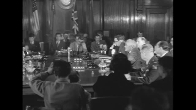 Soviet Union members of the Allied Council for Japan enter room and sit at table with council members from China the United States and the United...