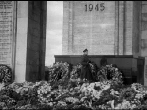 Soviet War Memorial in West Berlin Russian soldier patrolling TU to Soviet soldier statue MS Soldier standing guard w/ light machine gun