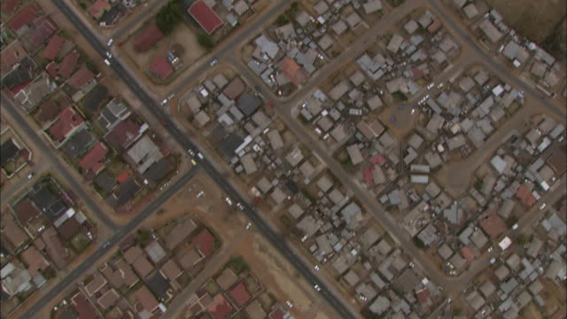 soweto highways, fields, vegetation and houses are seen from the sky. - soweto stock videos and b-roll footage