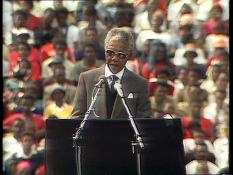 soweto nelson mandela speech from platform in stadium: (short bit at beginning missing because pictures not transmitted, also very bad quality signal... - speech stock videos & royalty-free footage
