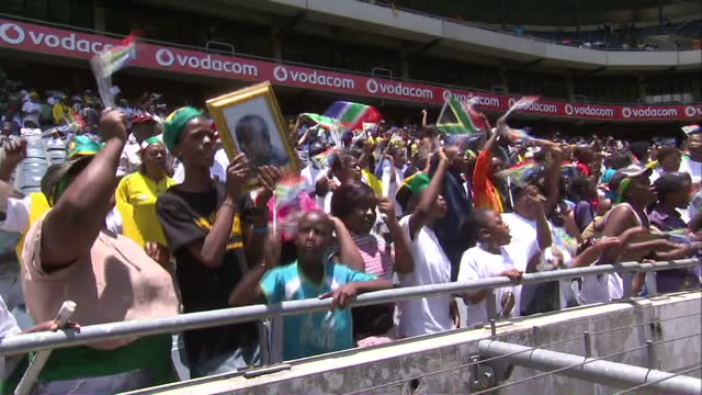 soweto residents gathered at the orlando stadium to watch events from the funeral of nelson mandela in qunu on big screens michelle clifford reports... - nelson mandela stock videos and b-roll footage