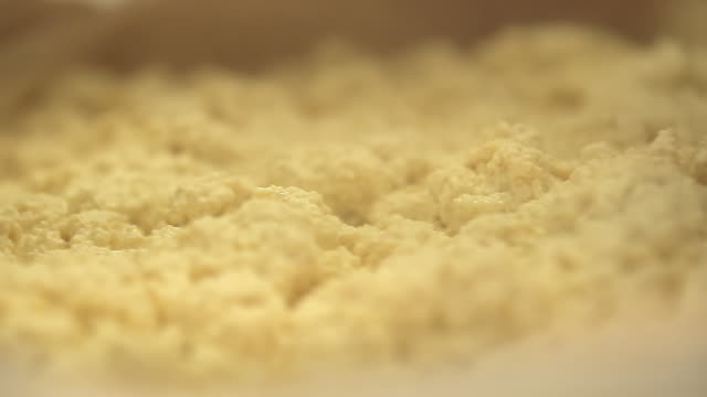 soy milk is mixed and curded - soy milk stock videos and b-roll footage