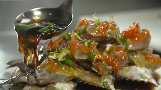 Soy Sauce Being Poured on Ganjang Gejang(Soy Sauce Marinated Raw Crab)