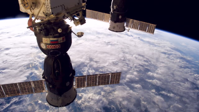 soyuz spacecraft is now the main vehicle used in missions and crew transfers to and from the international space station since nasa retired the space... - international space station stock videos & royalty-free footage