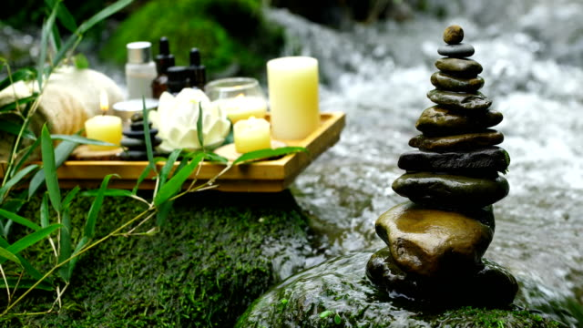 spa concept with zen stone in stream - lily stock videos & royalty-free footage