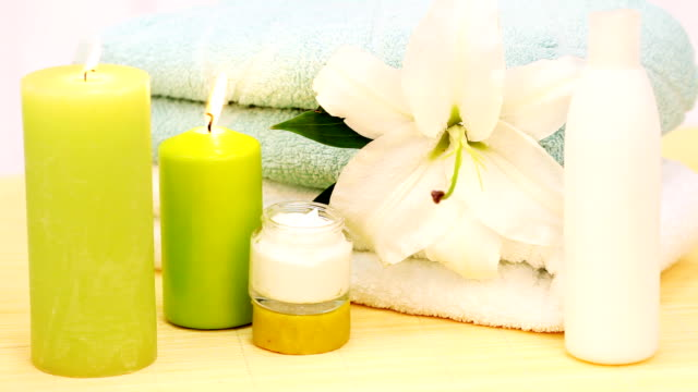 spa decoration.  towels, candles and cream. - beautification stock videos and b-roll footage