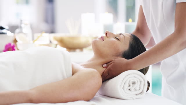 spa retreats have broad health impacts - massage stock videos & royalty-free footage