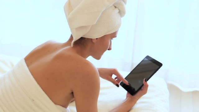spa & tablet - wearing a towel stock videos and b-roll footage