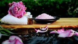 spa zen relaxation with pink waterlily lotus and pink himalayan salt on water slowmotion flowing , keep and calm meditation , work life balance concept