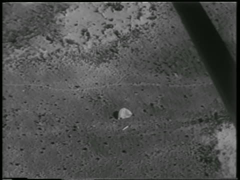 space capsule + parachute on ground in desert / spacecraft carried animals - new mexico stock videos & royalty-free footage