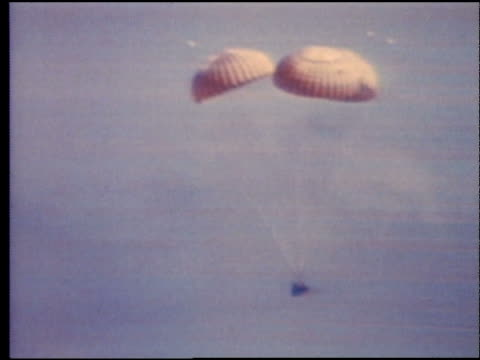 space capsule with parachutes splashing down / apollo 16 - splashdown stock videos and b-roll footage