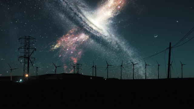 space galaxy vortex. wind turbines silhouettes - power station stock videos & royalty-free footage