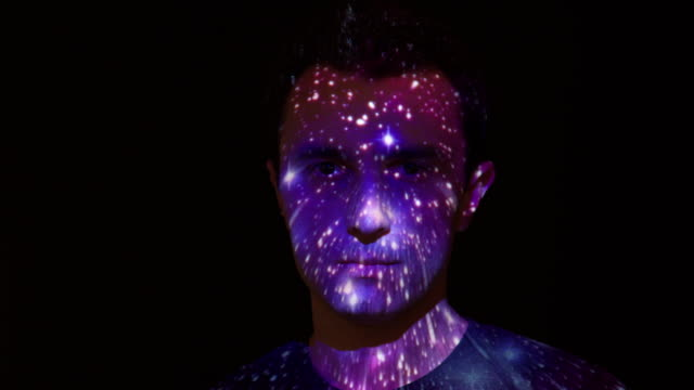 Space journey projection on man's face