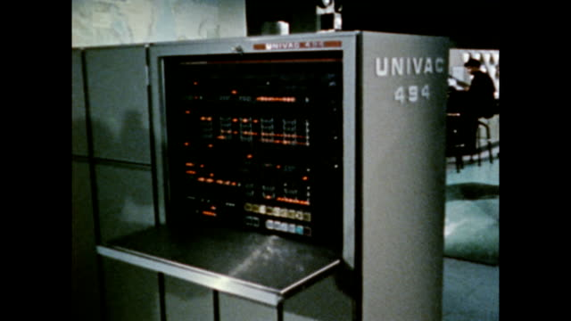 / space maps generated by satellites are printed in room / univac 494 computer console space maps being printed out in computer room on january 01,... - 1971年点の映像素材/bロール