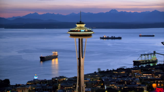 aerial space needle and elliott bay with queen anne at night - seattle stock-videos und b-roll-filmmaterial