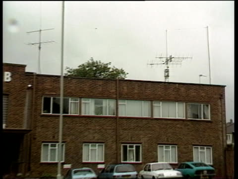 england potters bar ms rsgb building zoom in aerial on roof three radio hams sitting at controls as one speaks on microphone - audio electronics stock videos & royalty-free footage